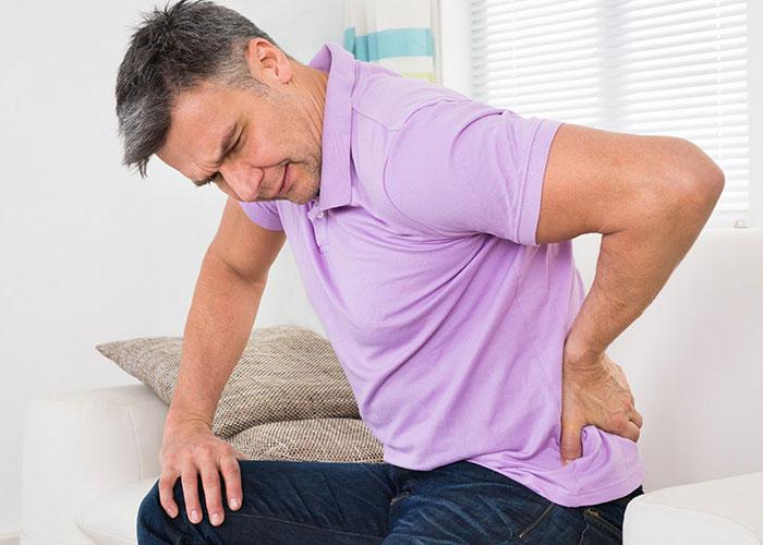 Боль в пояснице: причины, классификации, лечение и профилактика